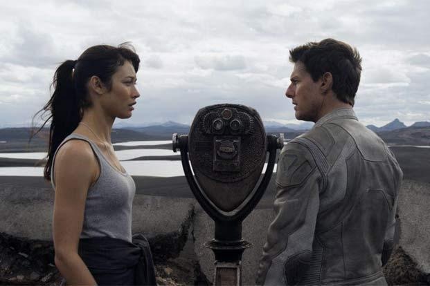 Olga Kurylenko (left) and Tom Cruise in a still from 'Oblivion'