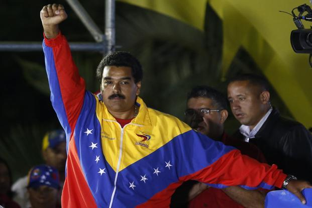 Venezuelan presidential candidate Nicolas Maduro celebrates after the official results gave him victory in Caracas on 14 April. Maduro, handpicked heir to Hugo Chavez won a tight election with 51% of votes, the electoral authority said. Reuters