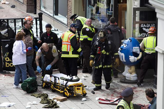 First responders tend to the wounded where two explosions occurred along the final stretch of the Boston Marathon on Boylston Street in Boston, Massachusetts, US, on Monday. Photo: Bloomberg