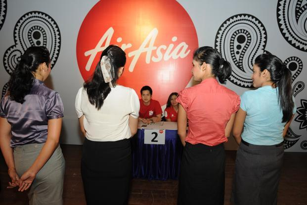 Smile, but if you have tattoos, you're not welcome at Air Asia
