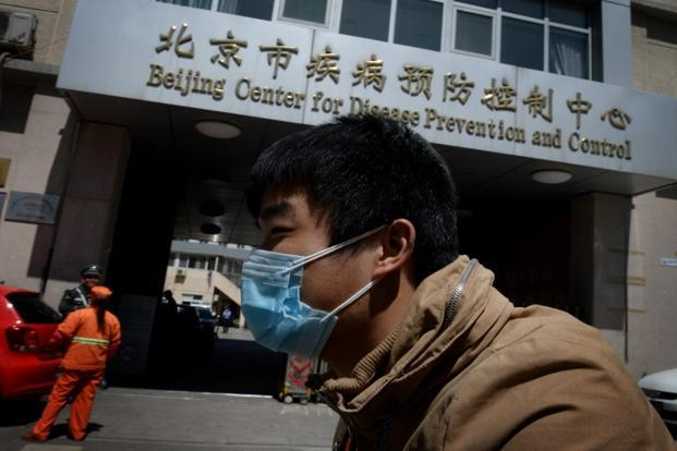 A Chinese man arrives at the Beijing Center for Disease Prevention and Control as the country deals with the H7N9 bird flu virus. Photo: Mark Ralston/AFP
