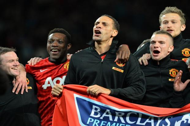 (From Left) Manchester United's Wayne Rooney, Danny Welbeck, Rio Ferdinand and Tom Cleverley (Front R) celebrate at the final whistle after they beat Aston Villa. It meant United had its 20th English league title ever since it first won in 1908. AFP