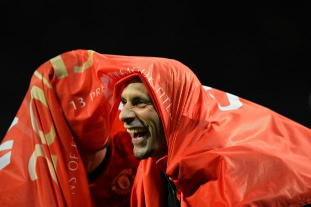 United's English defender Rio Ferdinand who joined the club in 2002 for a then record fee of £30 million celebrates his team's victory. United is the most successful club in domestic competition in England, having won 13 of the last 20 league titles. AFP