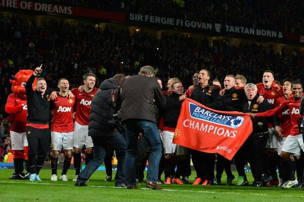 Manchester United players celebrate their return to winning ways. The 3-0 win over Aston Villa on Monday, keeps the team on course for the highest points tally in the history of English football, beating Chelsea's 95 points in 2004-05. AFP