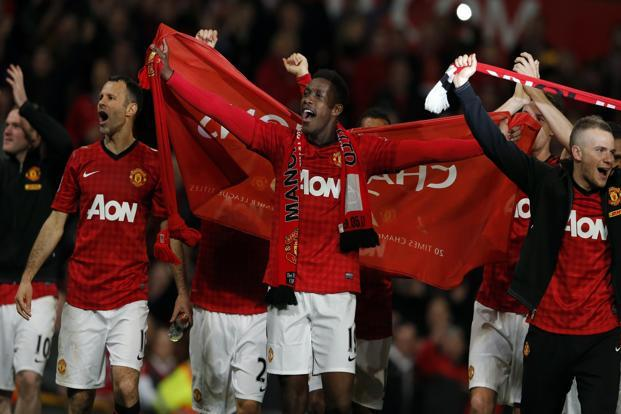 (From Left) Manchester United's Ryan Giggs, Danny Welbeck and Tom Cleverley celebrate their team's victory. Along with Ferguson, the 39-year-old veteran Welshman Giggs has also won 13 Premier League titles. Reuters