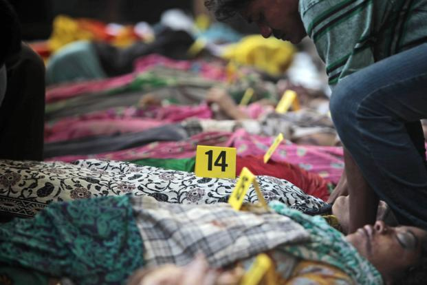 Bodies of victims of the building collapse lie numbered in a row. Bangladesh is the world's second largest garment exporter. Prime Minister Sheikh Hasina has announced a national day of mourning in memory of the victims on Thursday. AP
