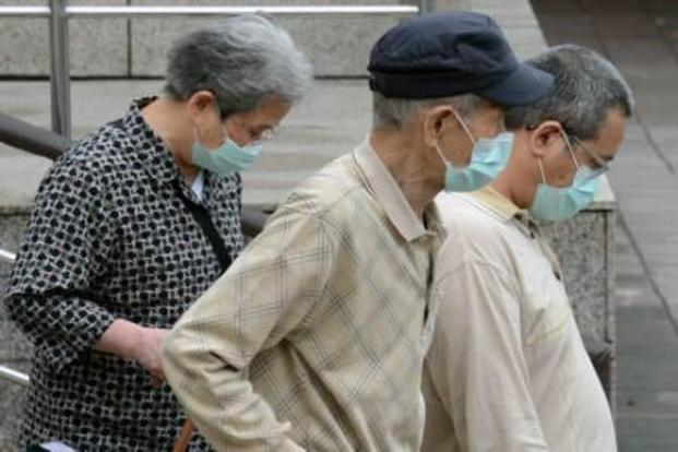 People outside the National Taiwan University Hospital in Taipei on Thursday. This week, a man in Taiwan become the first case of the flu outside mainland China.Photo: Sam Yeh/AFP