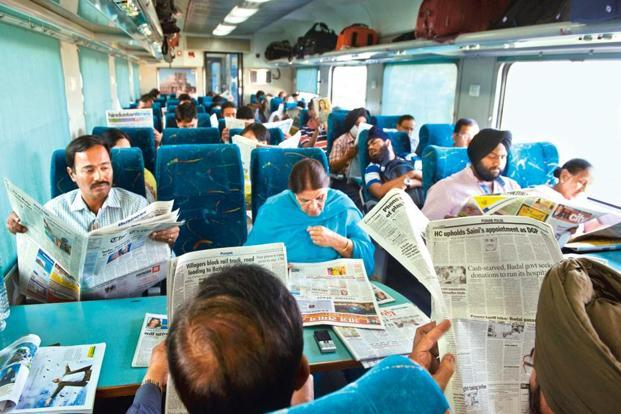photo essay newspaper nation livemint reading the newspaper seems to be a popular pastime for these passengers on the new delhi
