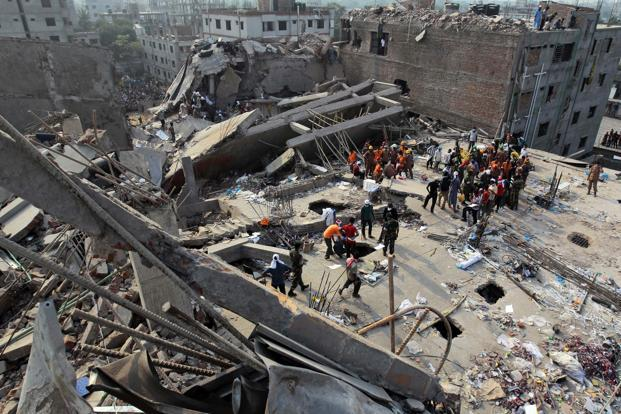 Bangladeshi rescuers work at the site of a building that collapsed on Wednesday in Savar, near Dhaka. Photo: AP
