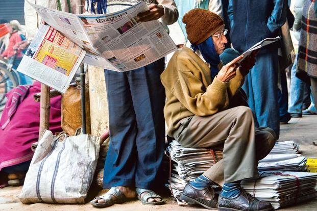 Photo Essay  Newspaper Nation  Slideshow  Livemint At Chandni Chowk In Old Delhi Two Men Are Engrossed In Their Copies Of The