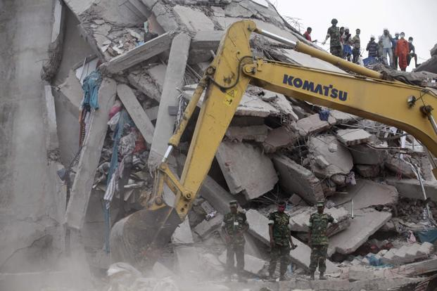 Army soldiers clear up the rubble of the collapsed Rana Plaza building with a bulldozer in Savar, 30 km outside Dhaka. Photo: Reuters