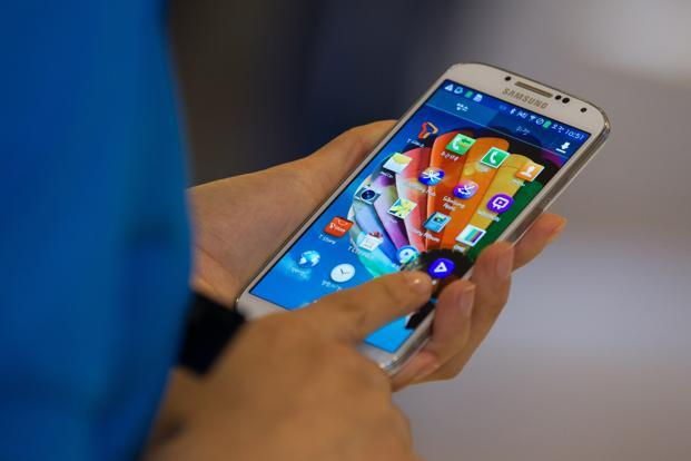 Samsung India currently imports the recently launched Galaxy S4 from South Korea. Photo: SeongJoon Cho/Bloomberg