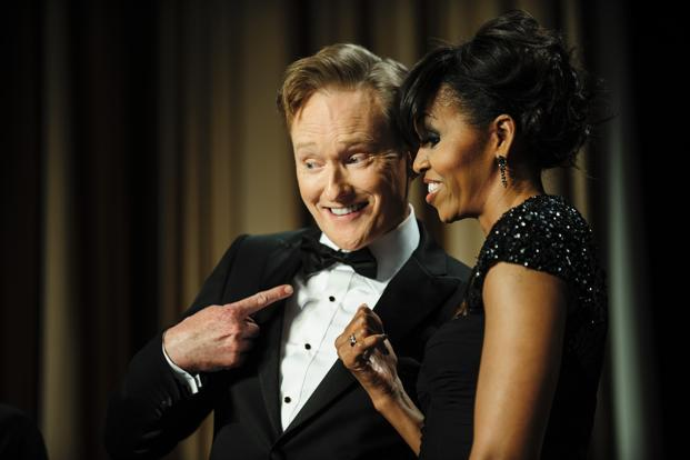 Comedian Conan O'Brien and First Lady Michelle Obama smile for the cameras during the dinner. AFP