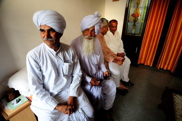 Inder Singh coordinator of the 24-village Hooda khap, with other khap members. In 2011, the Supreme Court said khap panchayats were illegal and had to be 'ruthlessly stamped out'. Photo: Pradeep Gaur/Mint (Pradeep Gaur/Mint)