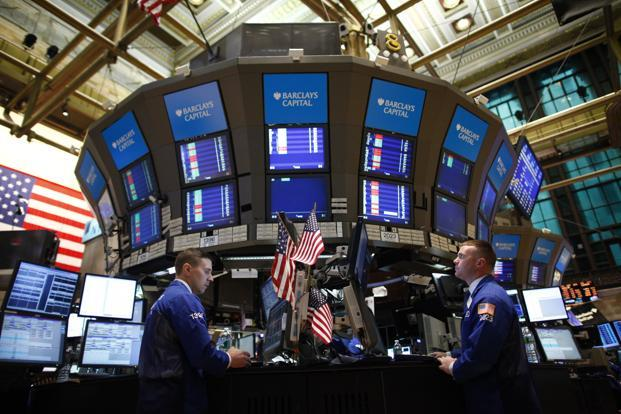Traders work on the floor of the New York Stock Exchange (NYSE) in New