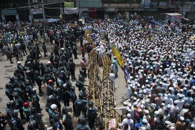 Supporters of the Hefazat-e-Islam movement blocked nearly all the roads leading into Dhaka, and set fire to office of the Communist Party of Bangladesh while ransacking several business establishments in Purana Paltan in central Dhaka. AP