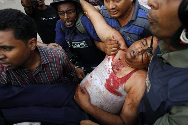 An injured police officer is carried off. PM Sheikh Hasina, who rubbished these demands in April, held a meeting with party colleagues, while the opposition Bangladesh Nationalist Party, expressed its support to the protesters. Reuters