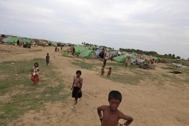 A boy stands outside an internally displaced persons (IDP) camp for Muslims, outside Sittwe. Photo: Reuters