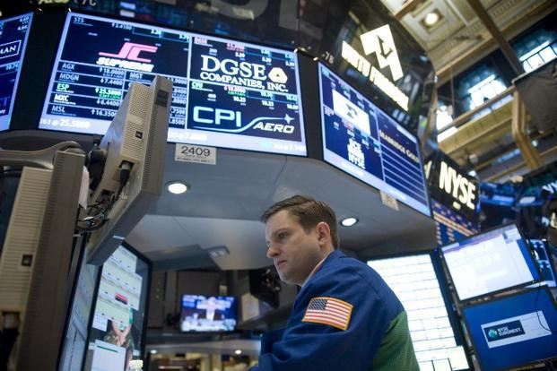 Traders work on the floor of the New York Stock Exchange. Photo: AFP