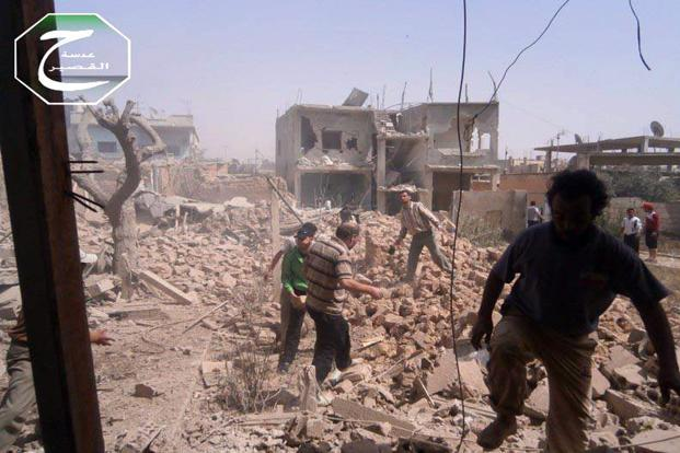 Government airstrikes reduced parts of Qusair to rubble, a Saturday image provided by Qusair Lens shows. Photo: AP (AP)