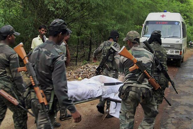 Indian security personnel carry the body of one of the victims of Saturday's Maoist attack in Bastar, about 345km south of Raipur, Chhattisgarh, on Sunday. Photo: AP  (AP )