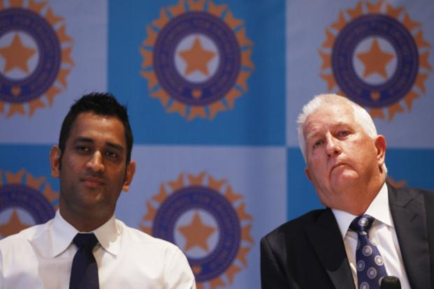 A file photo of Mahendra Singh Dhoni (left) and Duncan Fletcher addressing the media at Hyatt Regency in Mumbai. Photo: HT
