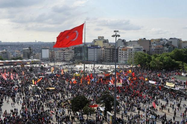 Protesters gather at Taksim Square on 2 June 2013. As the protests continued on Monday, it increased the pressure on Turkey's Islamist-rooted government which is responsible for unpopular laws like the one restricting the sale and consumption of alcohol. AFP