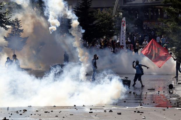Demonstrators clash with riot police during a protest against Erdogan. The unrest began as a sit-in over plans to redevelop Gezi Park in Istanbul's Taksim Square, but escalated after police used tear gas and water-canons. Reuters