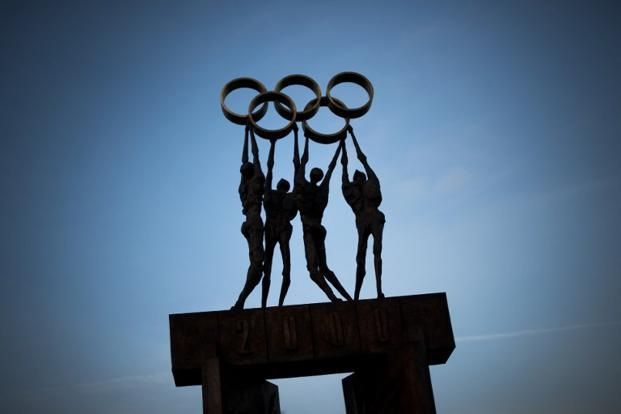 A sculpture representing people carrying the Olympics rings stands outside the IOC headquarters in Lausanne. AFP