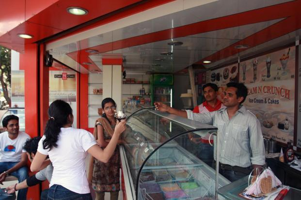 Ice-cream manufacturers are also pushing larger pack sizes and a variety of flavours into the Rs2,500 crore organized ice-cream market. Photo: Hindustan Times