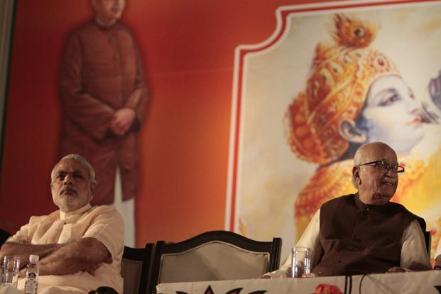 28 September 2012: Gujarat CM Narendra Modi with Advani. If Advani's resignation from all party posts is accepted, it will have to handle the transition from the Vajpayee-Advani to one of a new generation of leaders led by Narendra Modi. HT