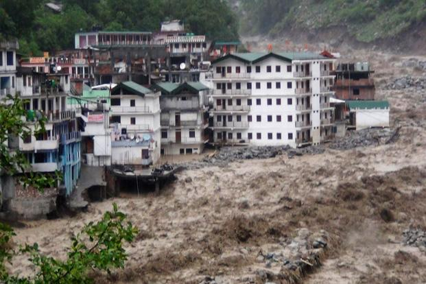 Flood waters from the Alaknanda river destroy buildings following heavy monsoon rain in Govindghat town, Uttrakhand on 17 June. More than 150 people have lost their lives due to the flooding but the final count could be much higher. AFP