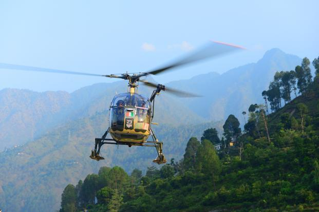 An Indian army chopper takes off for rescue operations at Gauchar air strip, near Rudraprayag. Photo: Ramesh Pathania/Mint