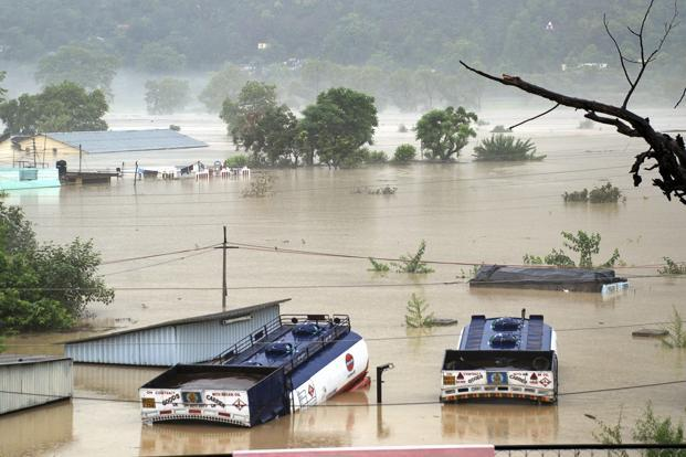 Submerged houses and trucks afloat in the flood waters of the Bhagirathi River in Shrinagar district of Uttarakhand.Hundreds of pilgrims enroute to the Char Dham Yatra - Badrinath, Gangotri, Kedarnath and Yamunotri- continued to be trapped. AP