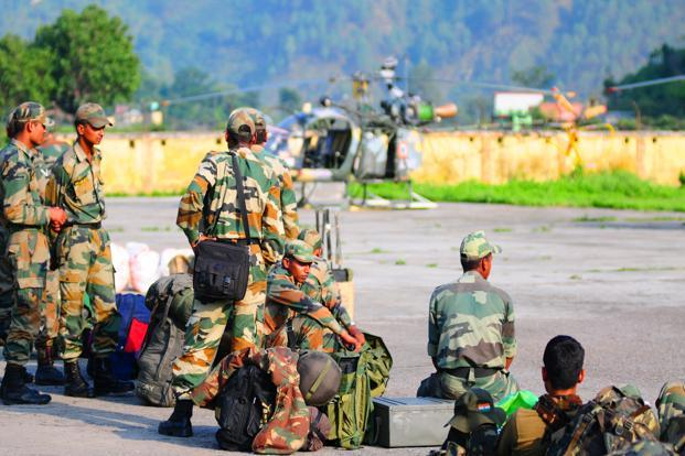 Indian army troops get ready for rescue operations at Gauchar air strip, near Rudraprayag. Photo: Ramesh Pathania/Mint