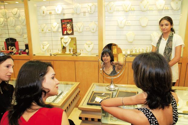 Globally, gold fell 0.9% to $1,339.55 an ounce, the cheapest since 20 May in Singapore on Thursday. Photo: Mint