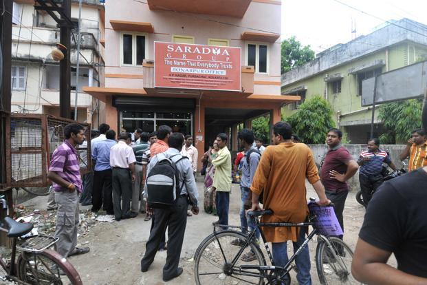 A file photo of agents outside a Saradha office in Sonarpur, South 24 Parganas district. Photo: Indranil Bhoumik/Mint  (Indranil Bhoumik/Mint )