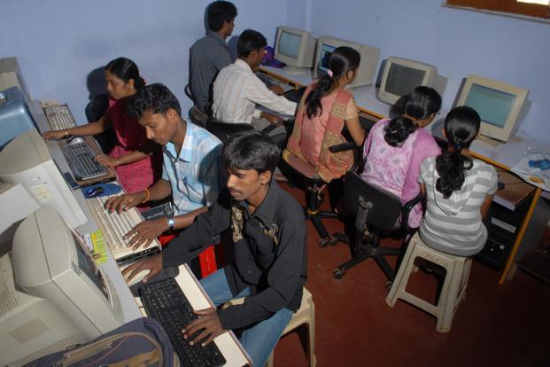 Villagers, even if illiterate, do not see computers and Internet as something they cannot learn fast. Photo: Hemant Mishra/Mint