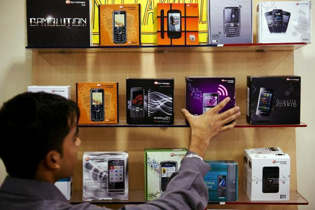 Indian companies, having already made an impact on the basic phone market, made the progression to smartphones over the past year or so by taking advantage of a market created by Samsung and others by offering lower-specification devices at lower prices. Photo: AFP
