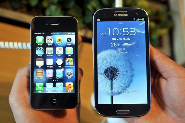 The decision on Wednesday by US Magistrate Judge Paul S. Grewal is part of a second patent case in San Jose, California, between the companies covering technology in newer smartphones, including Apple's iPhone 5 and Samsung's Galaxy S III. Photo: AFP (AFP)