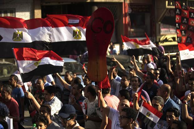 Egyptians march through the streets of Cairo on their way to join thousands protesting against President Mohamed Morsi and the Muslim Brotherhood at Tahrir Square on 30 June. Photo: AFP