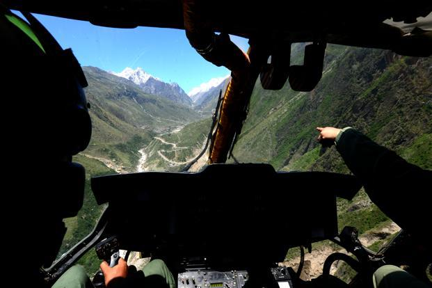 An army helicopter flies towards Badrinath during the rescue and relief operations. Photo: Ramesh Pathania/Mint