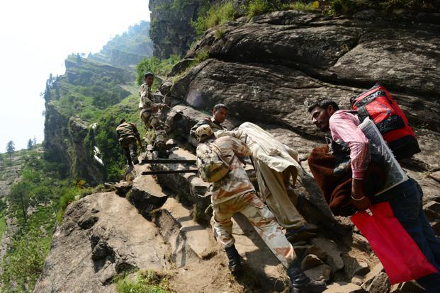 Indo-Tibetan Border Police mountaineers opened walking routes through steep mountainsides, cutting steps and fixing ropes, to evacuate people from Badrinath and Hemkund. Photo: Ramesh Pathania/Mint