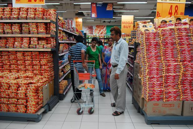 Over the past three years, Parle and its rivals Britannia Industries and Sunfeast maker ITC Foods have been passing on increased input costs to shoppers. Photo: Pradeep Gaur/Mint (Pradeep Gaur/Mint)