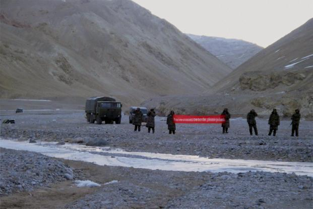 A file photo of intruding Chinese troops with a banner asking Indian soldiers to 'go back' in Daulat Beg Oldi sector of Ladakh. Photo: PTI
