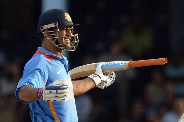 Indian cricket team captain M.S. Dhoni celebrates after hitting a boundary for six runs to seal their victory during the final match of the tri-nation series between India and Sri Lanka at the Queen's Park Oval stadium in Port of Spain on 11 July 2013. Photo: AFP