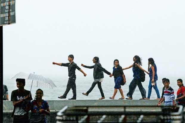photo essay rain diaries livemint teenagers enjoying the rains at the seafront on marine drive mumbai rajanish kakade