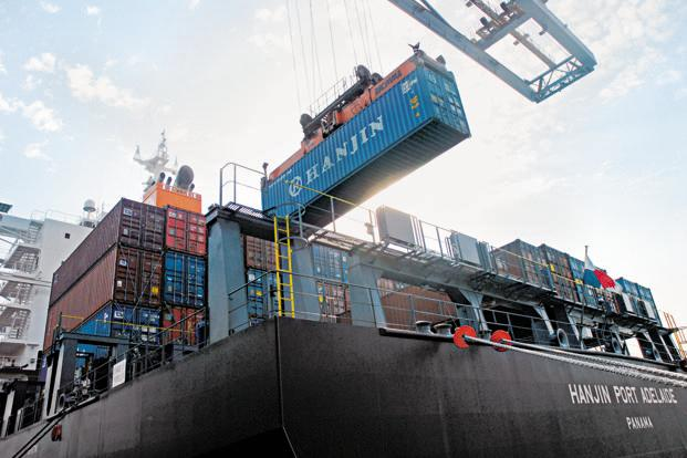 A file photo of Jawaharlal Nehru port near Mumbai. The shipping ministry plans to bid out 30 port projects worth `24,633 crore by March 2014 to add 288.48 million tonnes of cargo handling capacity at the 12 ports owned by the Union government. Photo: Mint (Mint)