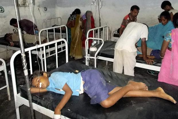 Schoolchildren receive treatment for food poisoning after consuming mid-day meal at a government primary school in Bihar's Saran district. At least 20 children in the age group 8-11 have died and many others have fallen sick after eating in the school. AP