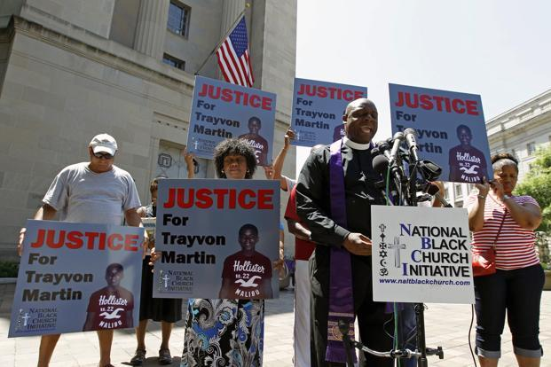 Rev. Anthony Evans, president of the National Black Church Initiative, leads a prayer during a demonstration asking for justice for Trayvon Martin in Washington. Reuters